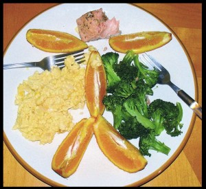 Salmon broccoli eggs and oranges.